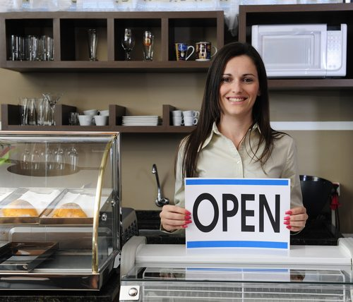 image of a woman with an open sign