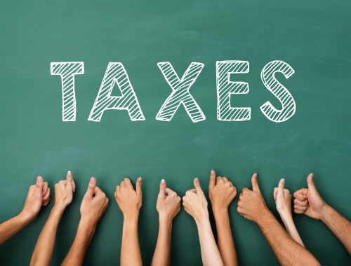 Image of people holding up thumbs under words taxes