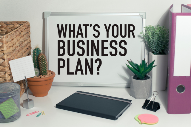 image of sign with what is your business plan